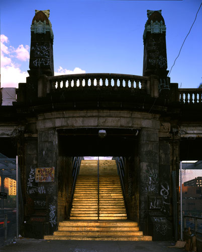 a gilded staircase in an old concrete bridge structure