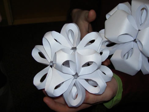 the paper polyhedra in somebody's hands