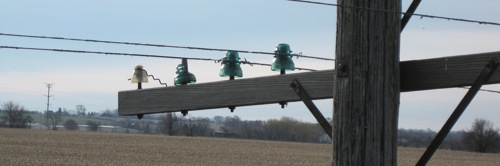 A pole with glass insulators