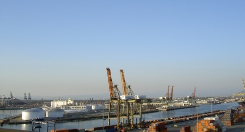 cranes, water, containers, and smog