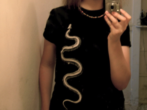a mirror picture of me wearing a shirt with a snake skeleton on it
