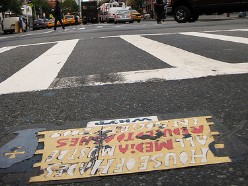 'House of Hades Toynbee tile in SOHO at the intersection of Waverly and 6th Avenue in NYC'